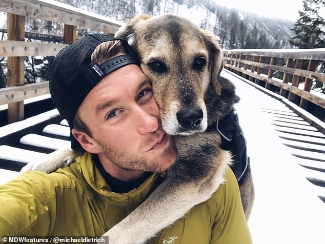 Best friends: Michael rescued BearBear, a German Shepherd-Labrador-Husky cross, after he found him freezing to death outside on New Year