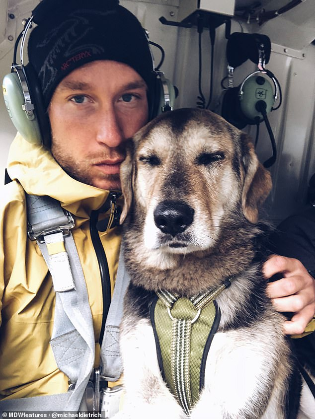 Further afield: Michael and BearBear on board a helicopter on their way to another adventure