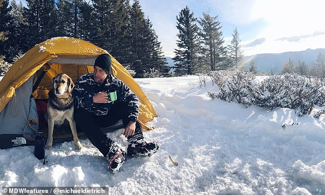 Back to nature: Michael and BearBear set up camp in the snowy mountains of Canada. Michael urged people to ditch their Netflix binges and nights on the couch for days in the outdoors