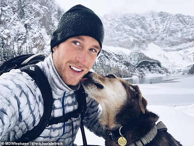 Quality time: Michael said the time he has with BearBear is more important than what he sees on his travels. Pictured, the pair snap an Instagram photo beside a frozen lake